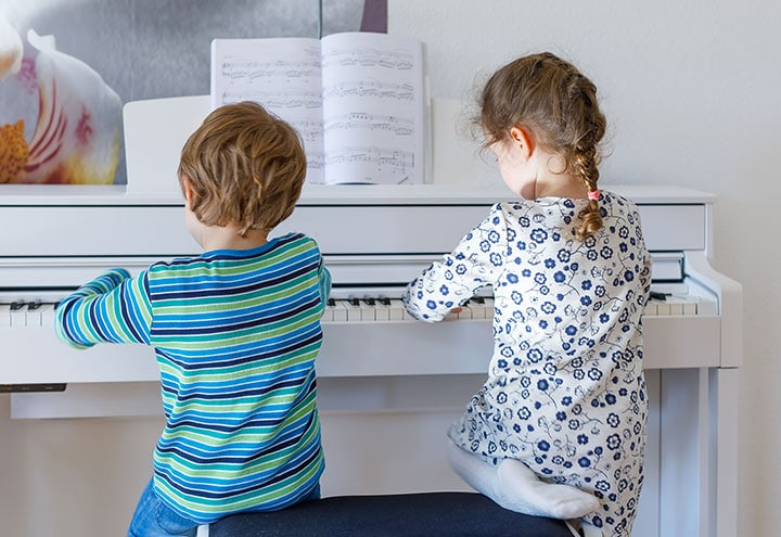 children learn to play piano